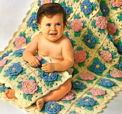 Granny squares with roses joined to make a wonderful crochet baby afghan.