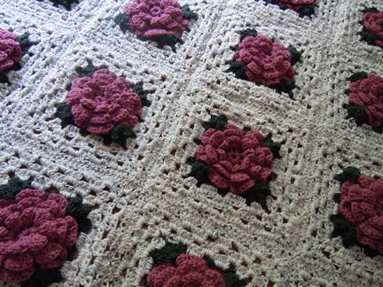 Crochet a rose granny square afghan in white pink and green